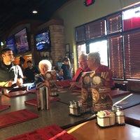 Photo taken at Boston's Restaurant & Sports Bar by Kathy J. on 10/4/2015
