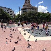 Photo taken at Plaça de Catalunya by Ekaterina S. on 6/8/2013
