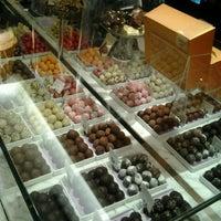 Photo taken at Godiva Chocolatier by KRick ★. on 5/7/2013