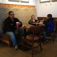 Photo taken at Starbucks by Liz N. on 12/1/2012