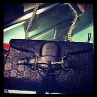 Photo taken at Gucci by Duygu S. on 12/6/2012