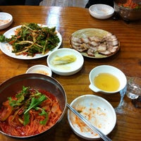 Photo taken at 장비빔국수와 편육 by YongWook S. on 1/4/2014