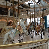 Photo taken at The Carousel @ Carousel Center by Jason Y. on 12/5/2013
