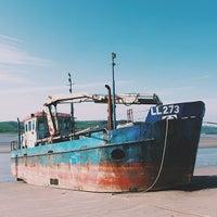 Photo taken at Llansteffan Beach by Sam M. on 4/16/2014