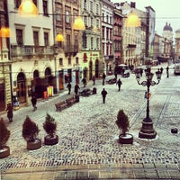 Photo taken at Rynok Square by Pavlo H. on 1/18/2013