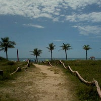 Photo taken at Praia dos Paraguaios by Laiana P. on 12/26/2012