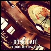 Photo taken at DÔME Café by Gunta R. on 6/30/2013