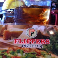 Photo taken at Flippers Pizzeria by Anthony B. on 8/9/2013