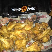 Photo taken at Wing Zone by Guille A. on 9/27/2012