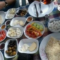 Photo taken at Zeynep Bacinin Yeri - Köy Kahvaltısı by Buğra Y. on 5/19/2013
