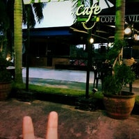 Photo taken at Coffee Village Cafe by Moja T. on 7/1/2013