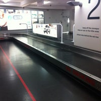 Photo taken at Baggage Claim by Sally-ann M. on 3/6/2013