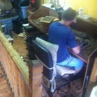 Photo taken at Lianos Dos Palmas Cigars by Tim G. on 5/24/2014