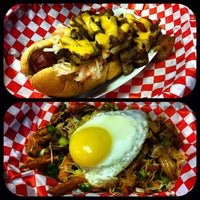 Photo taken at Buldogis Gourmet Hot Dogs by Justin G. on 10/25/2012