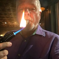 Photo taken at Churchill's Fine Cigars by Terry S. on 3/31/2016