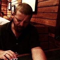 Photo taken at Smokey Bones Bar & Fire Grill by Alix M. on 6/25/2013