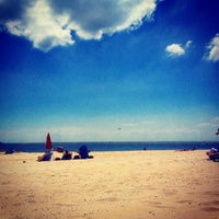 Photo taken at Point Lookout Beach (Town Park) by Caitlin I. on 6/14/2014