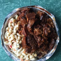 Photo taken at C & J Jamaican Restaurant by Brian R. on 6/19/2015