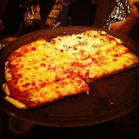 Photo taken at Bruno's Pizza and Big O's Sports Room by Andrew D. on 9/22/2012
