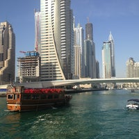 Photo taken at Dubai Marina Walk by E F. on 2/23/2013