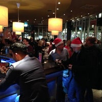 Photo taken at T.G.I. Friday's by Emre Berge E. on 12/6/2012