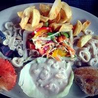 Photo taken at Brittos Bar & Restaurant by Roshan on 7/20/2013