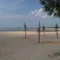 Photo taken at Pantai Puteri by Fatea A. on 10/27/2012