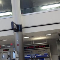 Photo taken at Gate E14 by Rose G. on 4/11/2013