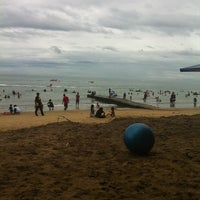 Photo taken at Pantai Teluk Kemang by Cikqaseh Q. on 12/25/2012