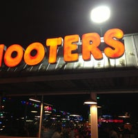 Photo taken at Hooters by Adrián R. on 12/30/2012