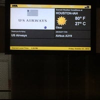 Photo taken at Gate E2 by Jessica C. on 10/24/2014