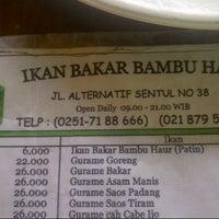 Photo taken at Ikan Bakar Bambu Haur by Irus S. on 8/10/2013