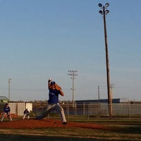 Photo taken at Buccaneer baseball field by Amanda S. on 4/10/2014