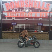 Photo taken at Bombshells Restaurant & Bar by Candice P. on 7/10/2013