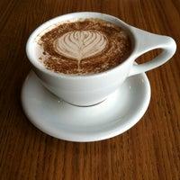 Photo taken at Atomic Coffee by Micah V. on 9/26/2012