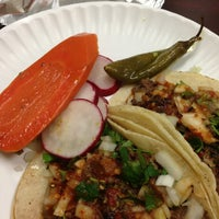 Photo taken at Los Compadres Taco Truck by Yolanda L. on 1/14/2013