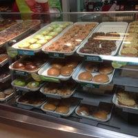 Photo taken at Krispy Kreme Doughnuts by Brian D. on 5/15/2013