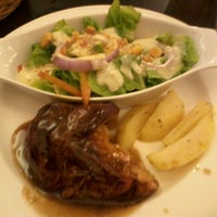 Photo taken at Kenny Rogers Roasters by astrid m. on 3/12/2013