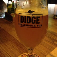 Photo taken at Didge Steakhouse Pub by Ana S. on 4/5/2013