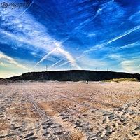 Photo taken at Playa de Salinas / San Juan de Nieva by GUAGUO I. on 6/16/2013