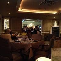 Photo taken at Jamie's Cigar Bar & Restaurant by Ahna H. on 10/14/2012