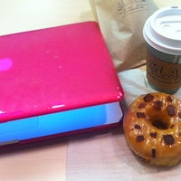 Photo taken at Glazed Gourmet Doughnuts by Ashley C. on 12/11/2012