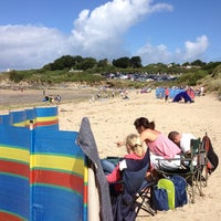 Photo taken at Daymer Bay by Ian K. on 8/18/2013