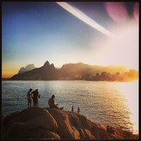 Photo taken at Pedra do Arpoador by Leandro O. on 7/12/2013
