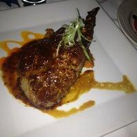 Photo taken at Four Restaurant by Scott D. on 3/6/2013
