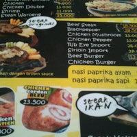 Photo taken at Waroeng Steak & Shake by Putri U. on 1/16/2013