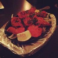Photo taken at Saffron Indian Cuisine by Jaysen N. on 11/3/2012