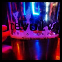 Photo taken at Revolver Bar & Lounge by Marc W. on 1/4/2014