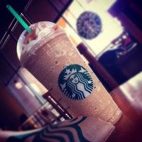 Photo taken at Starbucks by [t] m. on 11/12/2011