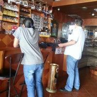 Photo taken at La Casa Del Habano by Maria L. on 4/18/2014